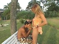Lascivious shemale massaging guy's tight ass outdoors after hot training