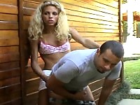 Curly shemale pulls up her skirt to dick her boyfriend's ass right outdoors