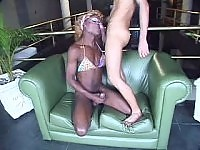 Nasty ebony shemale slut bending down and sucking on the couch