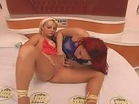 Redhead shemale getting into mood of doggystyle fucking with her girlfriend