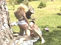 Picnic with shemale bound to end up with guy's ass-penetration on the lawn