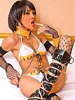 Hot t-girl getting equipped with cuffs and a leash