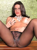 Naughty tranny spreading her pantyhosed legs wide to show her cock close-up