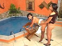 Brunette shemale tasting shemale's nyloned cock before fucking by the pool