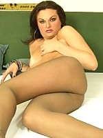 Playful shemale giving a glimpse of her rocky rod through grey pantyhose