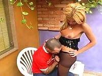 Sexy shemale pulling down her black hose longing for ass-fucking her lover