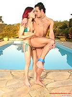 Redhead shemale and hot guy in wild fucking-from-behind frenzy by the pool